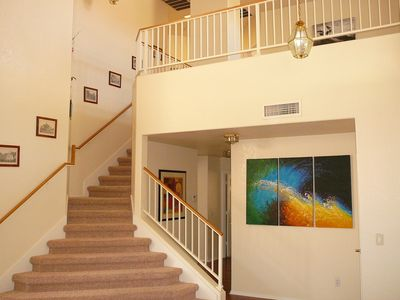 Staircase leading to master suite, second bedroom and study/loft