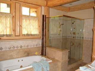 Cooperstown cabin photo - Master spa bathroom, multi body spray shower and jetted soaking tub