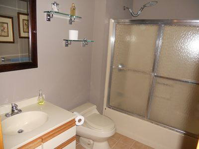 bathroom downstairs with bathtub