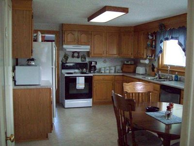 Laundry room is located off the kitchen