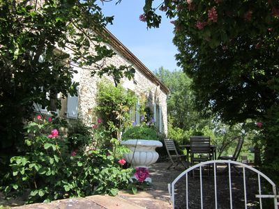 Charming and romantic companion house surrounded by a very beautiful garden.