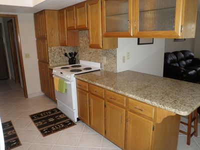 KITCHEN W/ GRANITE COUNTERS