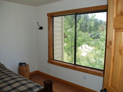 2nd Bedroom: expansive window with partial mountain view