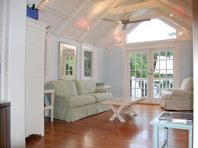 Vaulted Sun Room with Kable Lighting Overlooks Pool