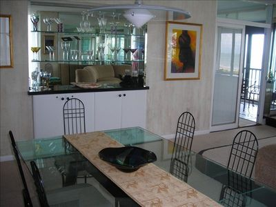 Bright and cheerful bar area with funky glassware, dining area for 6 or more