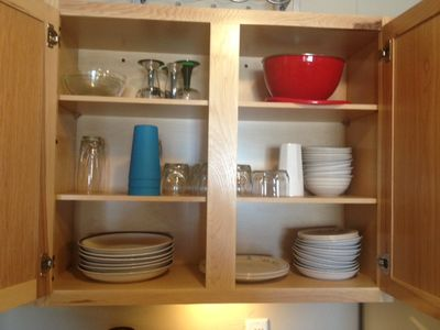 Cabinets equipped with plenty of dish ware and plenty of room for your own!