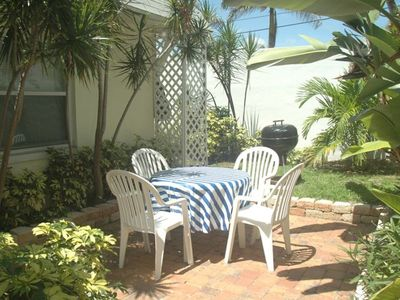 Enjoy dining on the back terrace off of sun room.