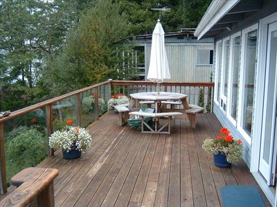 Large deck with a table for 8 for outdoor dining
