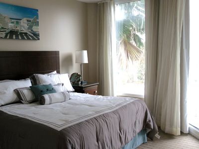 Palms of Destin condo rental - Master bedroom with glass sliding doors out to the balcony