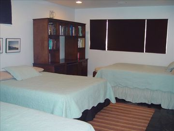 Basement room with 2 Queen beds and 1 Queen murphy Bed