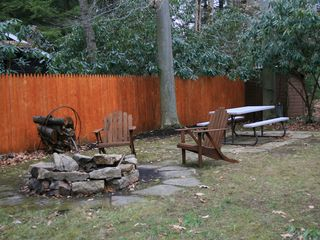 Clearfield cabin photo - Side yard with campfire ring and picnic table complete with privacy fence