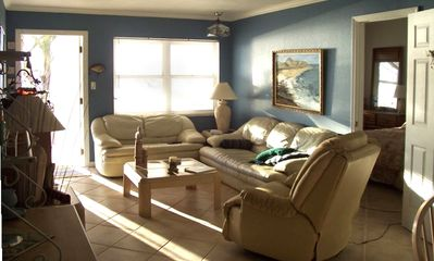 Living room with fabulous views of the Gulf of Mexico and beach condo/balcony...