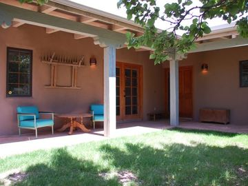 Casita courtyard with seating and gas grill.