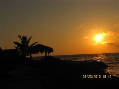 Roatan house rental - coffee always taste better with a Roatan sunrise