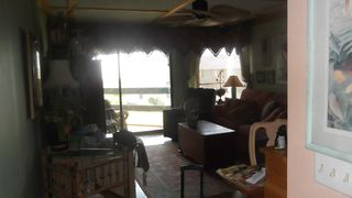 Harbor Island condo photo - View of living area & screened balcony. Decorated w/uniques & antiques.
