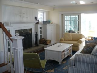 Bourne house photo - Living rm with fireplace & step out to sunroom