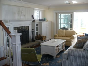 Living rm with fireplace & step out to sunroom
