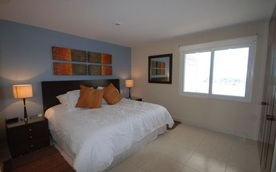 Bedroom with King Size bed, Luxury Linens, LCD TV/DVD, Air Conditioning
