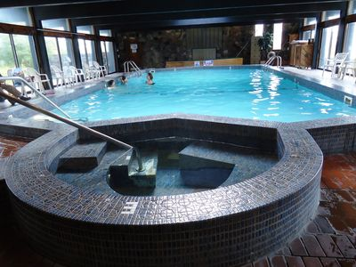 Indoor pool and hot tub at Summit