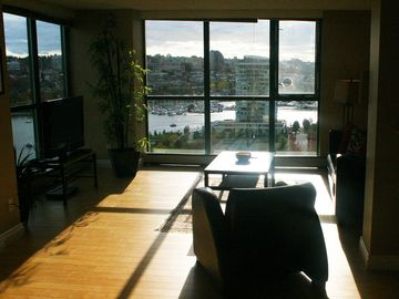 Afternoon light pouring in and a view across False Creek