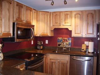 Breckenridge Peak 9 condo photo - Upgraded, well-stocked gourmet kitchen with stainless