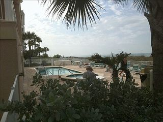 Indian Rocks Beach condo photo - View of gulf from pool and spa area