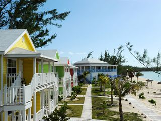 Governor's Harbour hotel photo - Cocodimama Resort showing the three cottages and the Main House