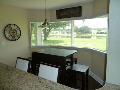 Breakfast area with view of golf course & lake, 6 stools total