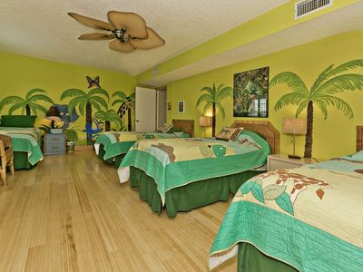 Kids 'jungle room' with four twin beds. Shares hall bath with downstairs queen