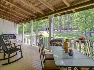 Franklin house photo - Rocking chairs and porch swing - best seats for watching the lightning bugs