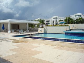 Fajardo condo photo - Main pool area with kids pool, whirlpool & lounges