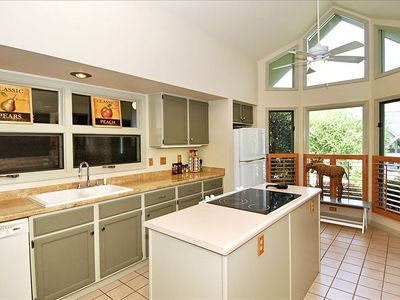 Inviting Kitchen Offers Lots of Counter Space & Adjoins Living/Dining Rooms