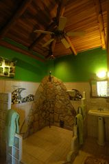 Interior Canopy Room Bathroom, Natural Rock Shower - Manuel Antonio villa vacation rental photo