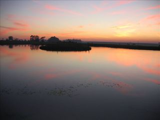 Maldonado farmhouse photo - SUNSET AT PRIVATE 2 ACRE LAGOON.