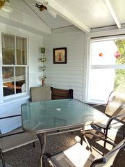 Wells cottage photo - Screened porch with new furniture.