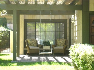 Enjoy your favorite book while sipping coffee in the shaded front porch