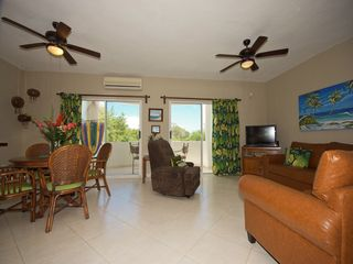 Playacar condo photo - Living and dining area with large terrace overlooking the pool
