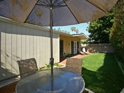 Backyard with Dining Table/Umbrella and Chaise Lounges