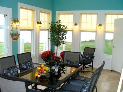 The vaulted sunroom with extra dining and easy chairs. Perfect for relaxing.