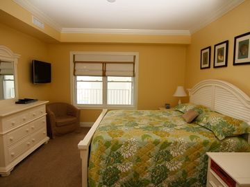 Second Master Bedroom with King bed dresser and wall mount HD TV