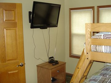 A TV for video games. All three bedrooms have six panel doors.
