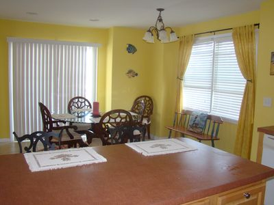 Lovely dining room has 5 very plush chairs and bench for extra seats.