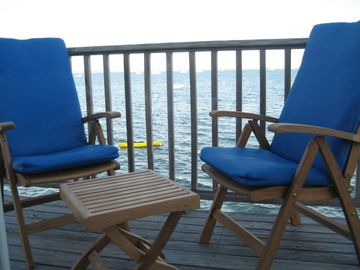 Exclusive use deck with teak furniture overlooking Provincetown Harbor.