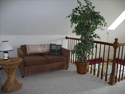 Upper level loft with water view.  Sleep sofa, flat-screen TV, DVD/VCR, library.