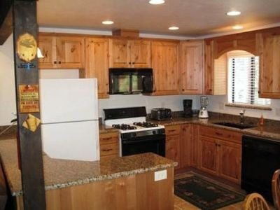 Newly-Remodeled Fully-furnished Kitchen with Granite countertops.