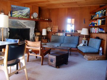 Tamarack cabin rental - living room and game/puzzle table to the left
