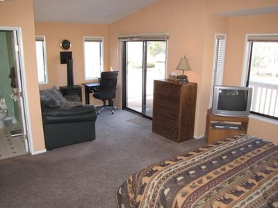Master suite has separate sitting area with fireplace & views.
