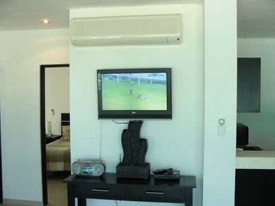 "Relax in with a 27"" flat screen in the main living room."