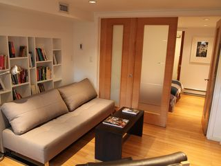 Brooklyn apartment photo - bedroom and living room with folding doors open