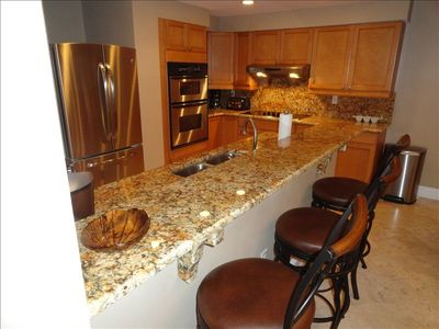 Breakfast Bar With Granite Countertops & Stainless Appliances